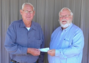 Sons Commander John Mohlis presenting check to WAVP committee members, Carl Benning