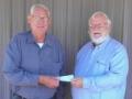 Sons Commander John Mohlis presenting check to WAVP committee members, Carl Benning